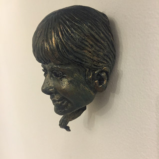 poly portrait on wall 2