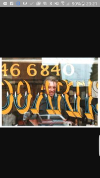 Barry through his shop window