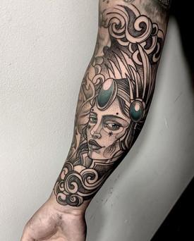 ornamental woman tattoo