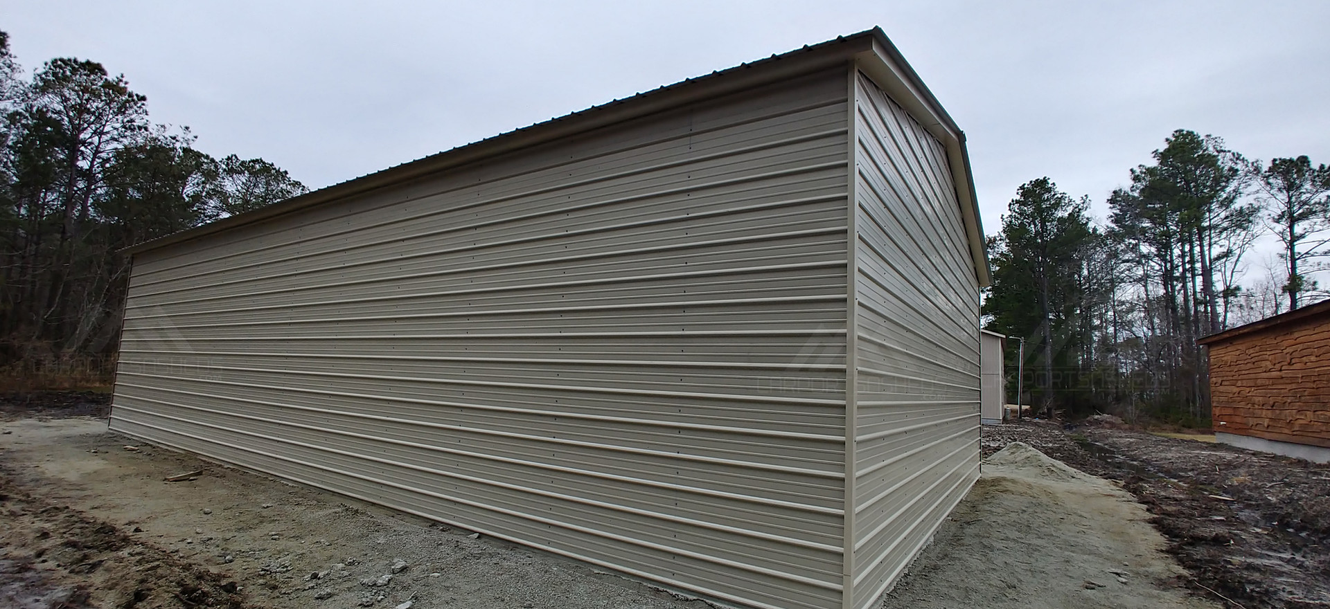 back and left side view of 30x50x12 Metal Garage