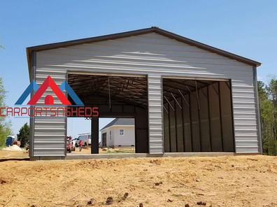 Metal building with drive trough door