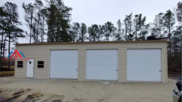 30x50x12 Metal garage with 3 roll up doors