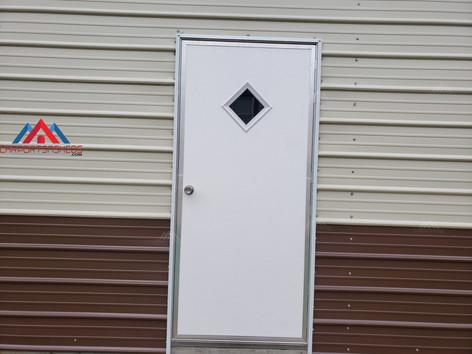 Walk in door on a 24x40 metal garage
