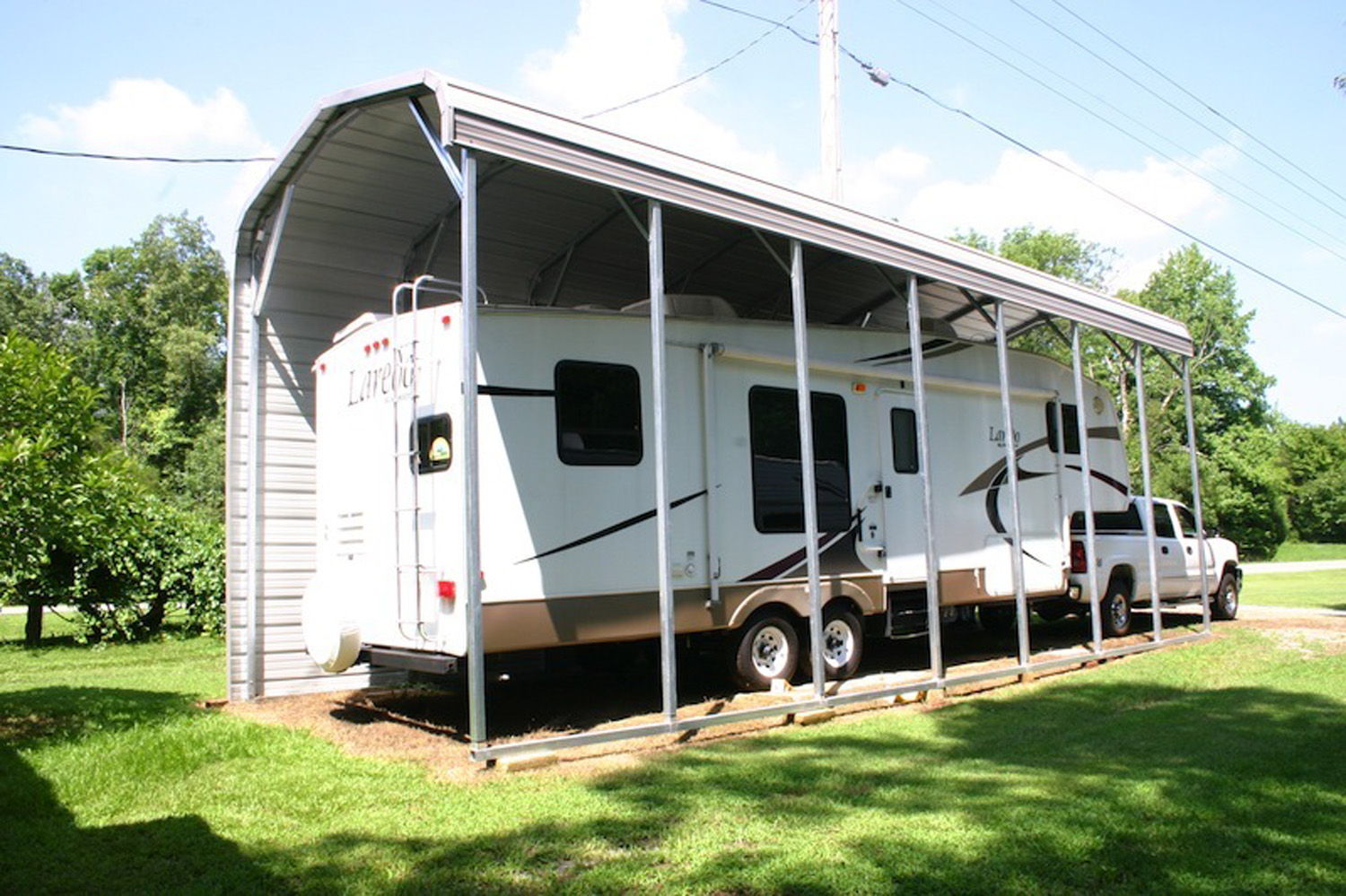Tips to purchase a metal rv carport for your rv garage for Rv buildings garages