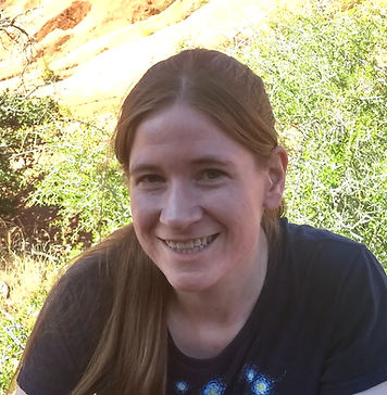 A white woman with dark blonde hair smiling at the camera.