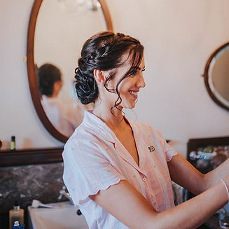 One of August's gorgeous brides checking