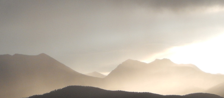 Mountain storm at sunset