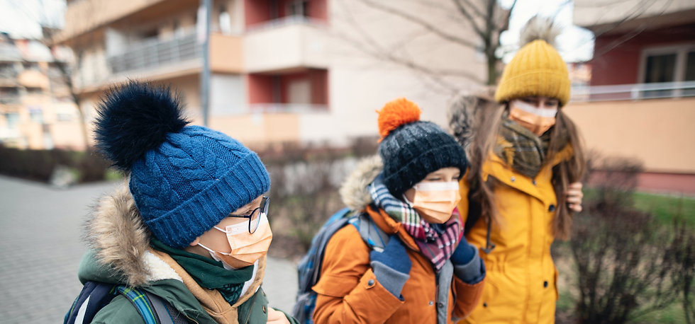 Schoolchildren walking together, wearing face coverings