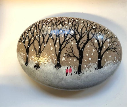 Walking in the Snow painted stone by Serena Sussex