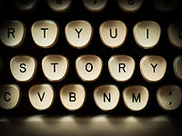 "A section of keys from a typewriter keyboard is displayed to emphasize the word ""story."""