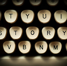 """Image of the word """"story"""" spelled out on the keys of a manual typewriter"""