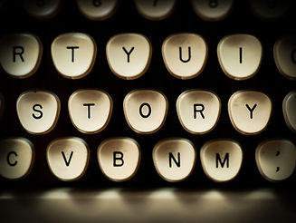 Typewriter keys that spell out STORY