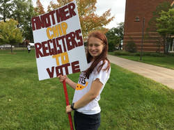 Mackenzie Clark holding sign