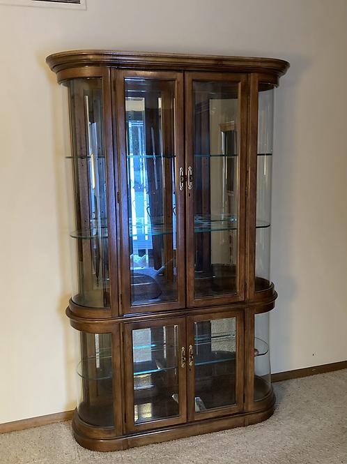 Semi modern curved glass china hutch.