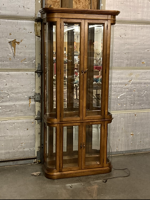 Lighted curio cabinet with beveled glass doors
