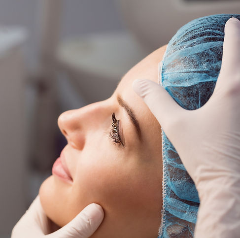 doctor-examining-womans-face-cosmetic-tr