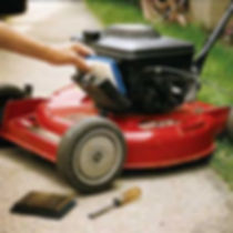 A push lawnmower's filter being changed