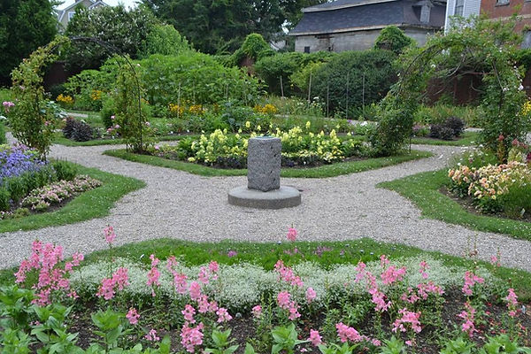 A landscaped property with garden beds and paths.