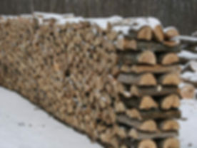Stacked firewood in the snow