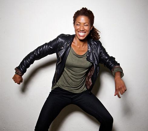 Eboni Adams with a big grin dancing