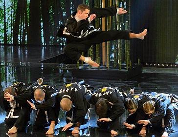 Richard Steel Jump Side kick over swords