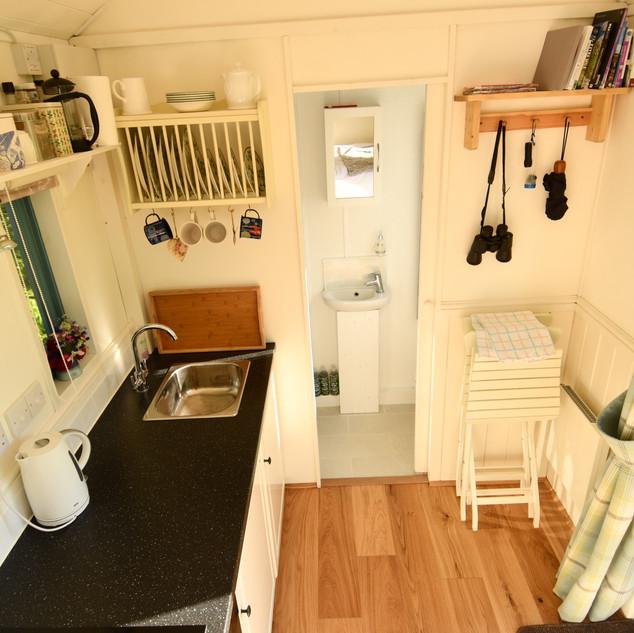 hut interior shelves.jpeg