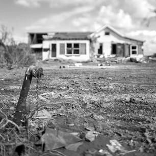 iron pipe and house, Cameron, LA