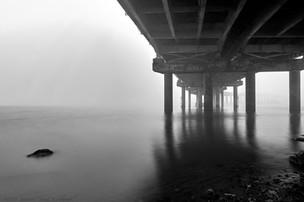 Under I-210 bridge, calm