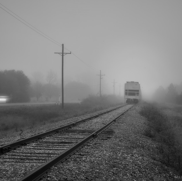 Car, train, fog