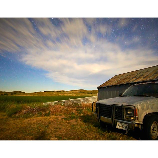 Night sky and pickup truck, NE