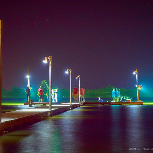 Men fishing at night