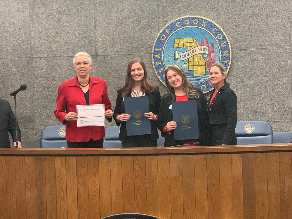 President Toni Preckwinkle and Distrct 12 Commissioner Bridget Degnen recognize Natalie Rohman and Callie Boboc for Love Where You Count in an official resolution