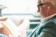 contemporary-senior-man-reading-in-cafe-