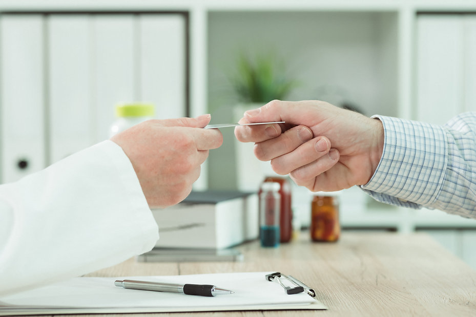 doctor-taking-medical-insurance-card-fro