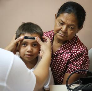 Patient in Crucitas clinic has temperature check