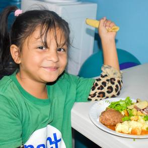 Student in Villa Nueva eats her lunch
