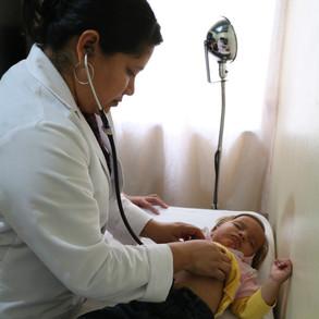 Dr. Garcia treats patient in Villa Nueva clinic