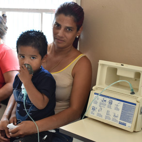 Patient in Crucitas clinic receives breathing treatment