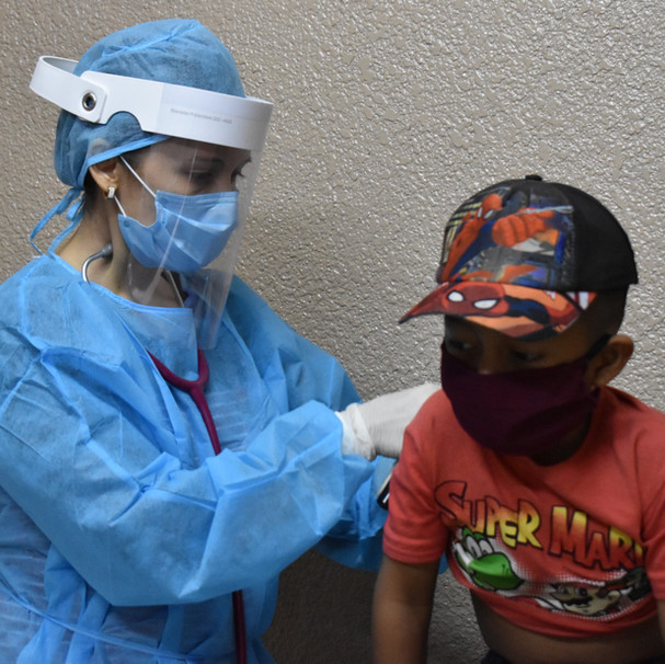 Dr. Espinal treats patients in the Crucitas clinic during COVID-19 pandemic