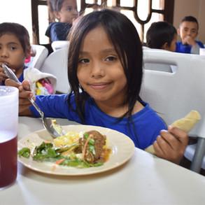 Student in Crucitas eats her lunch