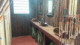 Mayan jungle inspired washroom facility at Serenity Retreats Belize - A Vegan Resort