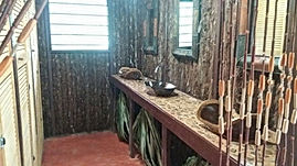 Mayan jungle inspired washroom facility at Serenity Retreats Belize - A Vegan Resort