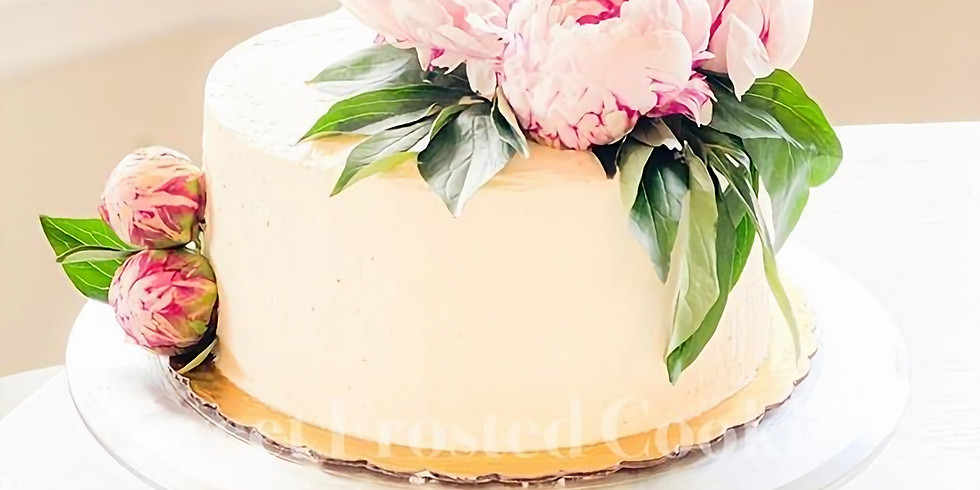 Learn How to Decorate Two Tiered Beautiful Cake Adorned with Fresh Flower