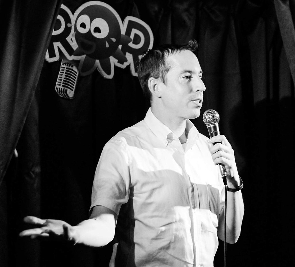 Dan Dorman performing at the sexy Osaka comedy club this year.