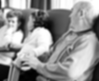 Photo of three elderly people in care home, sitting