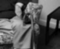 photo of a man in chair with a walking stick