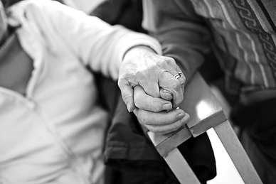 Close up of elderly couple's hands clasped