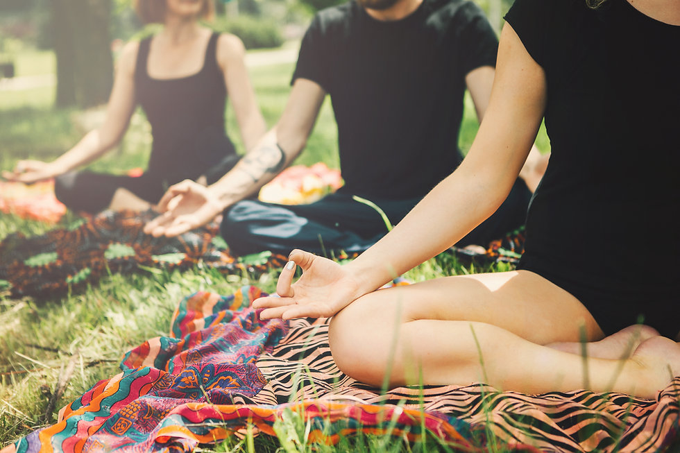 Young yoga practitioners in group doing