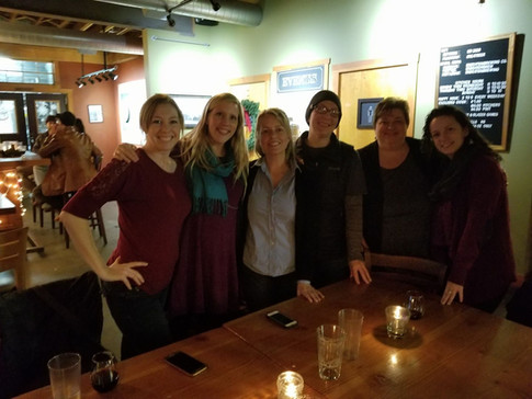 Six ORID members standing behind a table at an IPAHH event.