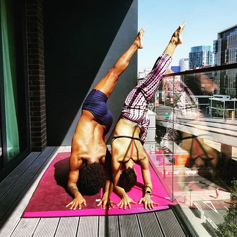 Olivia & Abdur doing some rooftop Yoga in London